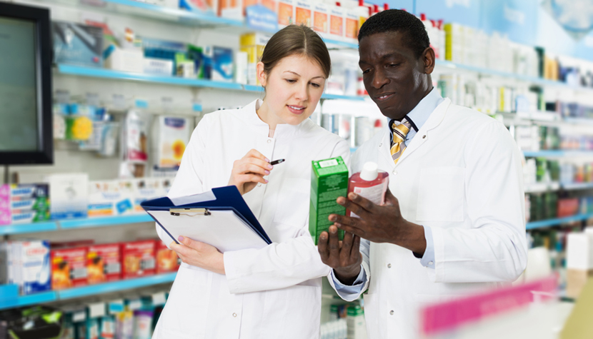 pharmacists taking inventory of medicines in pharmacy